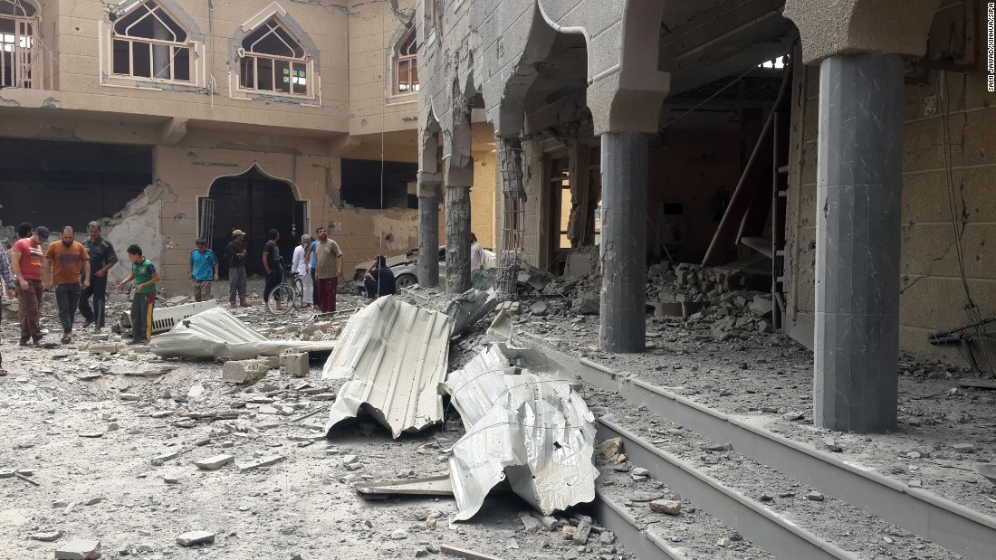 Residents check a shop-worn mosque after an Iraqi Air Force bombing in a ISIS-seized city of Falluja, Iraq, on Sunday, May 31. At slightest 6 were killed and 9 others bleeding during a bombing.