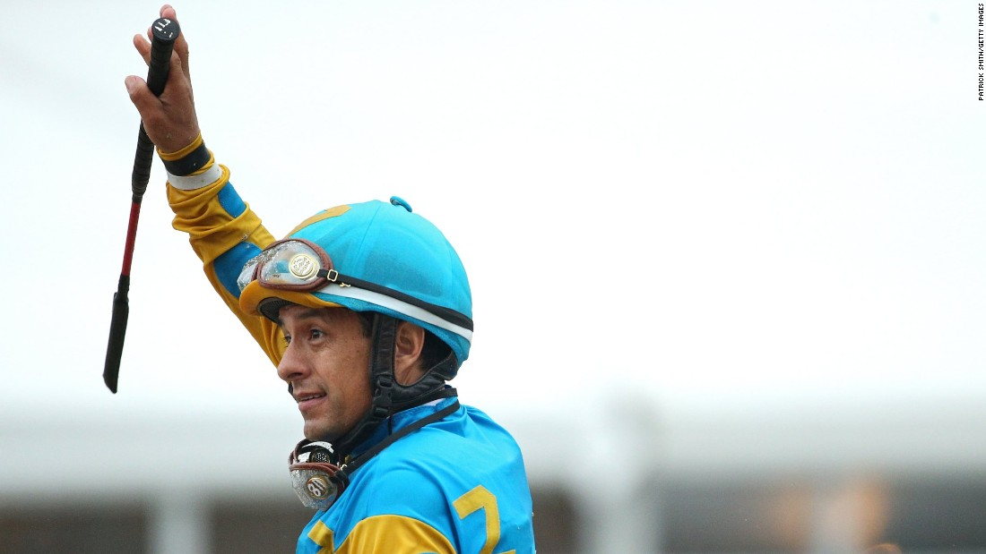Espinoza waves to the crowd after winning the Preakness.