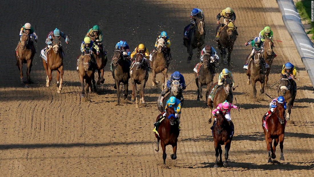 From left, American Pharoah, Firing Line and Dortmund lead the field as they head for the Derby finish line.