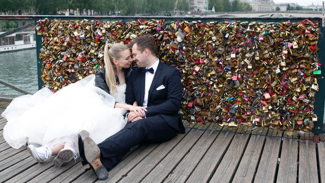 A married couple poses in front of the locks on Sunday, May 31.
