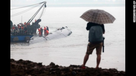 A man watches rescue efforts on June 2.