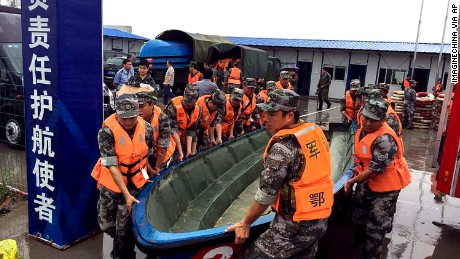 Chinese soldiers carry a boat to search for survivors on June 2.