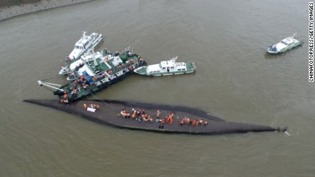 Rescuers search for survivors from the capsized ship.