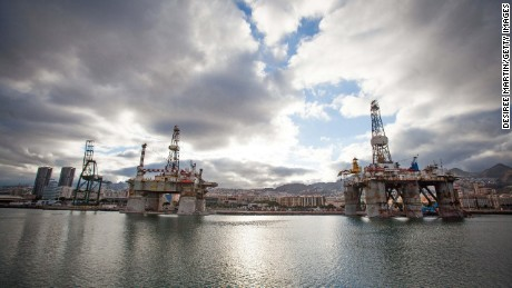 Oil Platforms undergoing maintenance are docked in the port of Santa Cruz de Tenerife on June 6, 2014. The Spanish government gave oil giant Repsol the green light to explore for oil and gas off the coast of the Canary Islands, a move that environmental groups described as 'unjustifiable'. AFP PHOTO / DESIREE MARTIN (Photo credit should read DESIREE MARTIN/AFP/Getty Images)