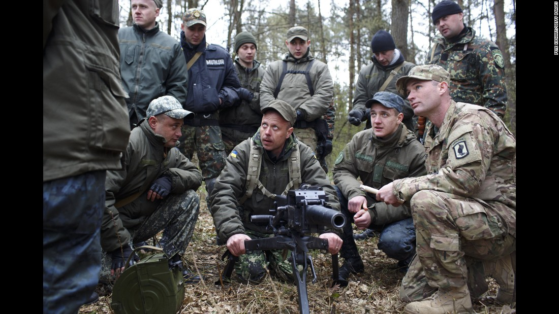 An American soldier, right, trains Ukrainian troops on Tuesday, April 21, near Yavoriv, Ukraine. Operation Fearless Guardian, a six-month training exercise, involves about 300 members of the American 173rd Airborne and about 900 Ukrainian National Guard troops.