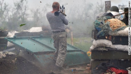 A Ukrainian serviceman fires a grenade launcher on the frontlines near Donetsk on Saturday, May 30.