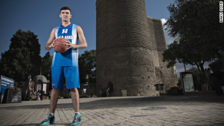 Azerbaijani basketball player Amil Hamzayev stands in front of the Maiden Tower in Baku#39;s Old City