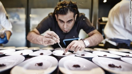 "Chef Gaggan Anand plates food at his eponymous Bangkok restaurant, Gaggan, which grabbed 10th spot at this month's ""World's Best Restaurant Awards."""