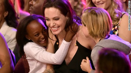 Jolie hugs her children Zahara Marley Jolie-Pitt, left, and Shiloh Nouvel Jolie-Pitt, right, after winning the award for Favorite Villain in 'Maleficent' during Nickelodeon's 2015 Annual Kids' Choice Awards on March 28.