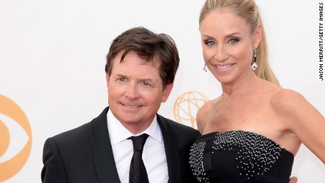 LOS ANGELES, CA - SEPTEMBER 22: Actors Michael J. Fox and Tracy Pollan arrive at the 65th Annual Primetime Emmy Awards held at Nokia Theatre L.A. Live on September 22, 2013 in Los Angeles, California. (Photo by Jason Merritt/Getty Images)