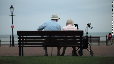 Senior citizens relax on Llandudno Promenade on September 8, 2014 in Llandudno, Wales. Britain is facing multiple problems stemming from an increase in the elderly proportion of its population, including increasing health care costs, strains on its social security system, a shortage of senior care workers and challenges to the employment market.