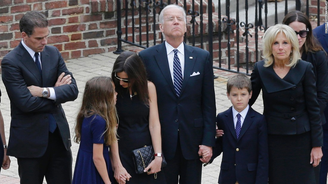 Joe Biden pauses with his family as they enter the visitation.