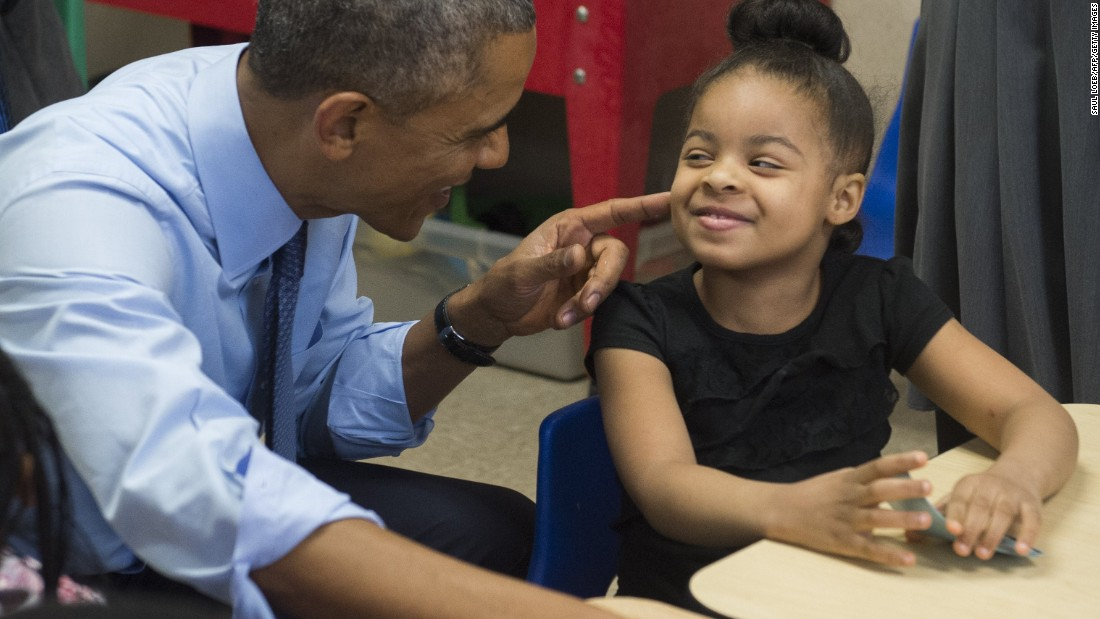 Obama talks with Akira Cooper during a visit to a classroom at the Community Children's Center, one of the country's oldest Head Start providers, in Lawrence, Kansas, in January.