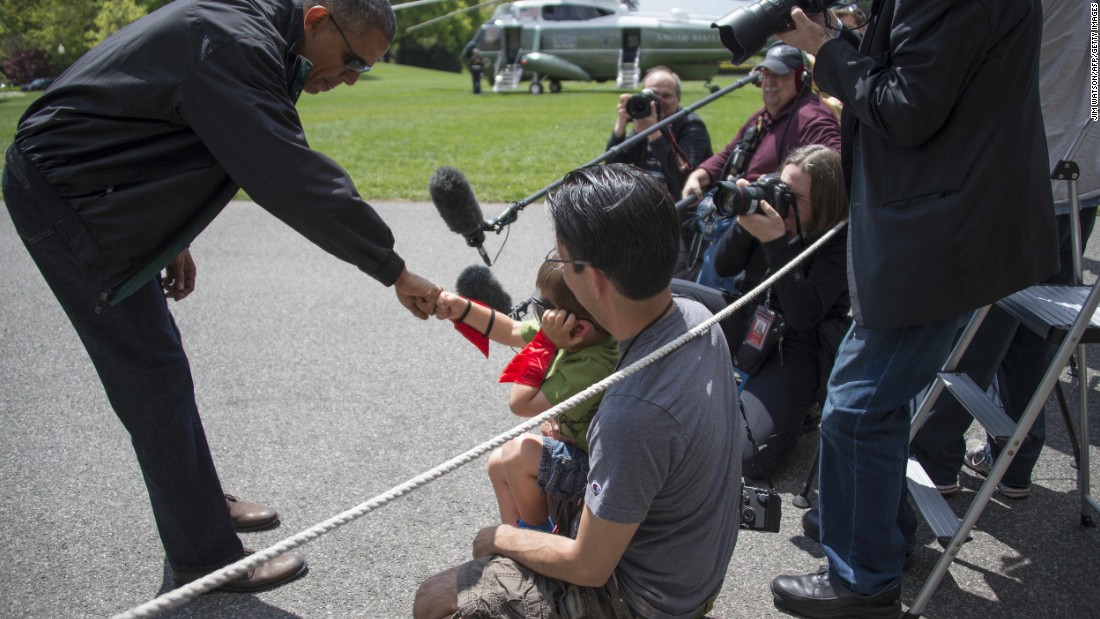As he departs the White House in May, Obama fist bumps with 4-year-old Luca Martinez, who is wearing a superhero costume.