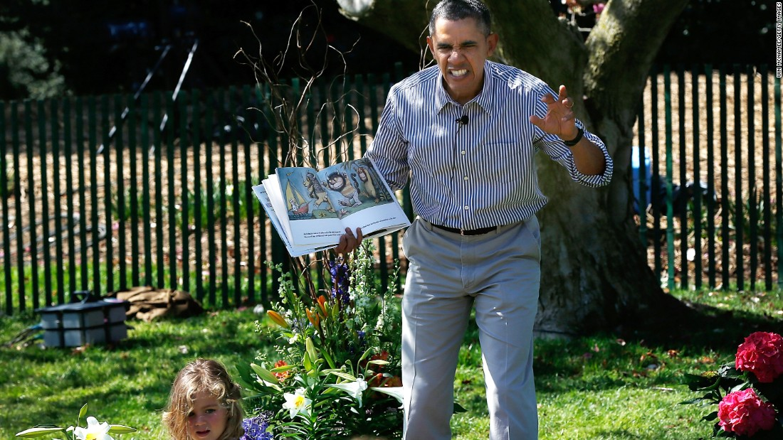 "Obama reads to children from the book ""Where the Wild Things Are"" by Maurice Sendak during the White House Easter Egg Roll in April 2014."