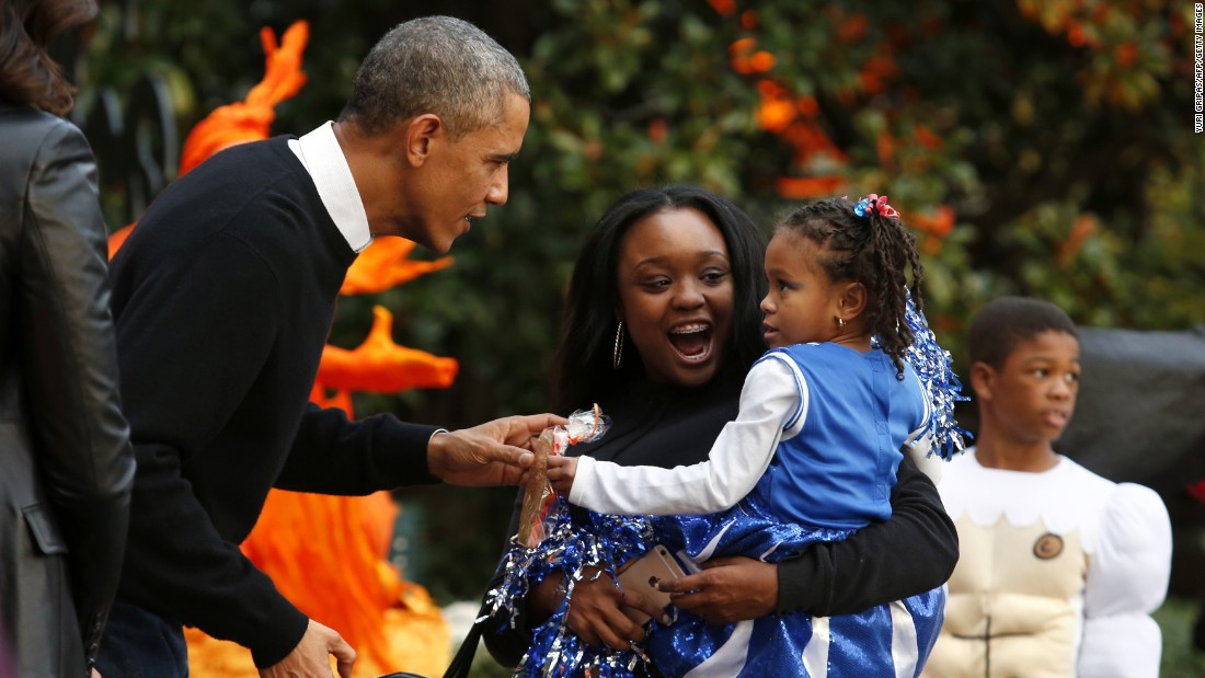 Obama greets trick-or-treaters at the White House in October 2014.