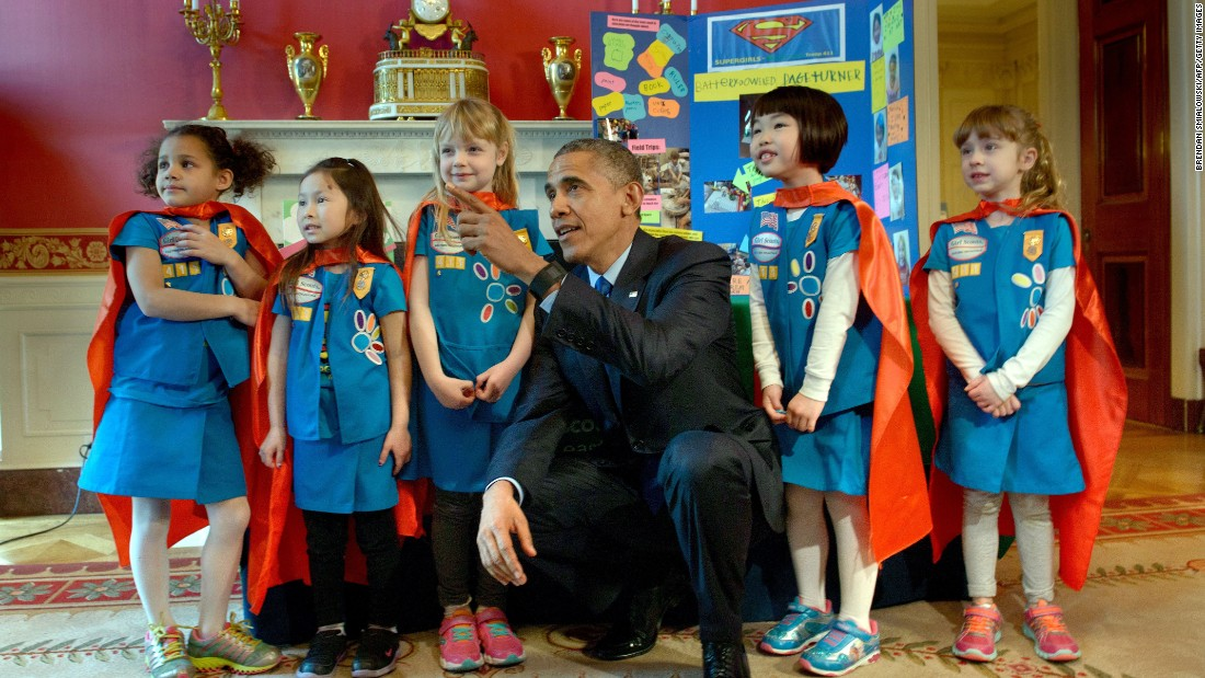 Obama poses with a Girl Scout Daisy troop from Tulsa, Oklahoma, during the White House Science Fair in March.