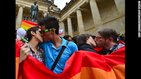 Same-sex couples kiss during a protest by the lesbian, gay, transgender and bisexual (LGTB) community demanding for their rigths --including the right to marriage -- at the Bolivar Square in Bogota,Colombia on November 27, 2012.