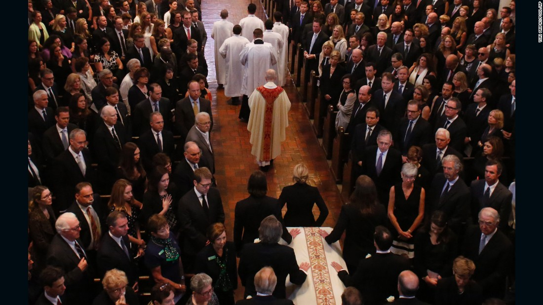 A procession carrying the casket of Beau Biden enters the church on June 6.