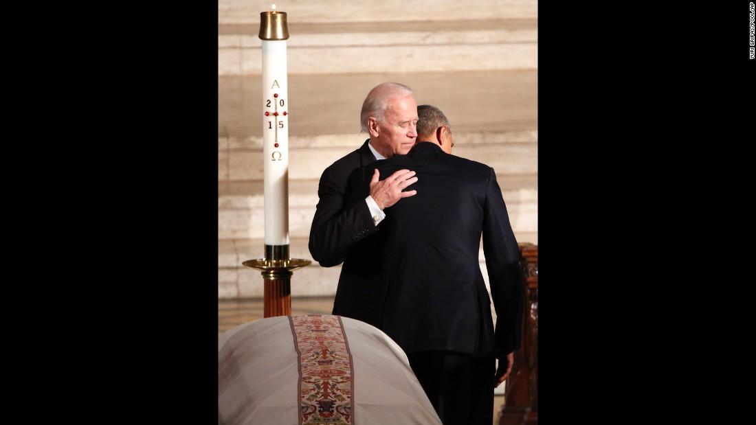Obama hugs Joe Biden during the funeral on June 6.