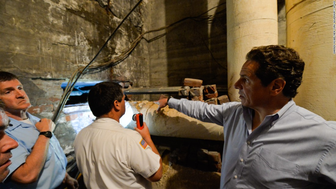 "Cuomo examines the escape route of the prisoners. ""It was elaborate, it was sophisticated,"" he said."