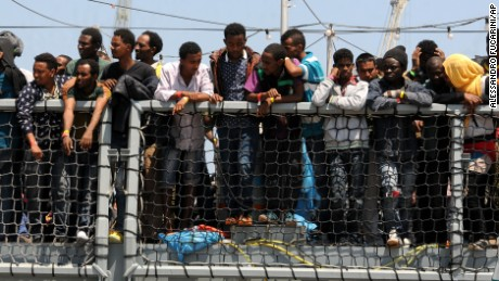 Migrants wait to disembark from the German Navy ship Hessen at the Palermo harbor, Italy, Sunday, June 7. European rescue boats are bringing thousands of migrants saved at sea to Italian ports.