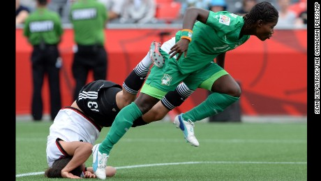 Germany#39;s Celia Sasic falls head first into the turf after a collision with Ivory Coast#39;s Sophie Aguie during a FIFA Women#39;s World Cup soccer action in Ottawa, Ontario on Sunday, June 7.  Germany defeate Ivory coast 10-0.