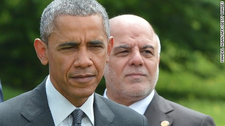 US President Barack Obama (L) and Iraq's Prime Minister Haider al-Abadi walk after posing for a group photo after the so-called 'outreach meeting' during the G7 Summit at the Schloss Elmau castle resort near Garmisch-Partenkirchen, in southern Germany on June 8, 2015.