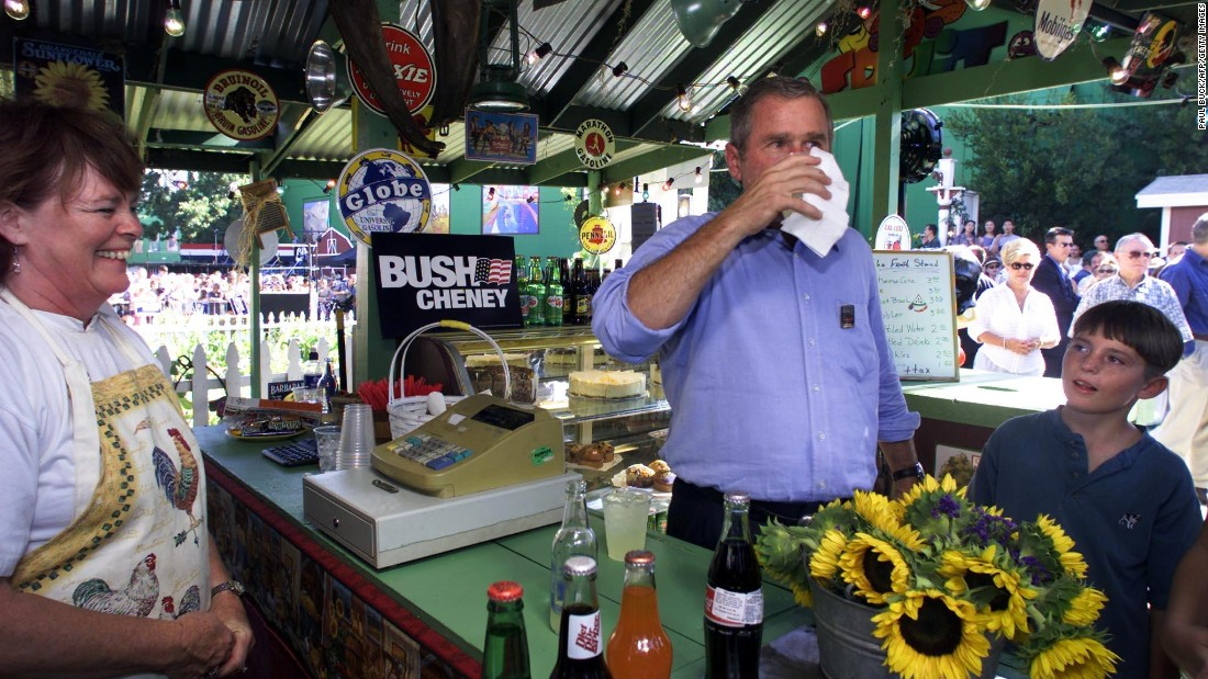 Bush, while running for president, pauses for a lemonade at the Los Angeles County Fairgrounds in Pomona, California, in September 2000.