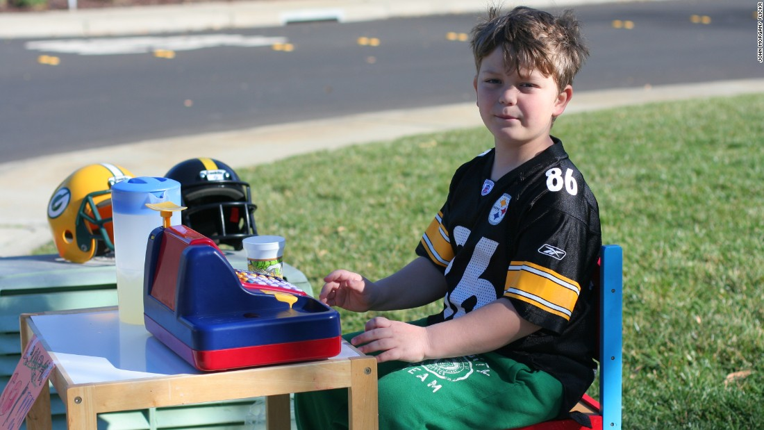 A young boy sets up a lemonade stand in February 2011.