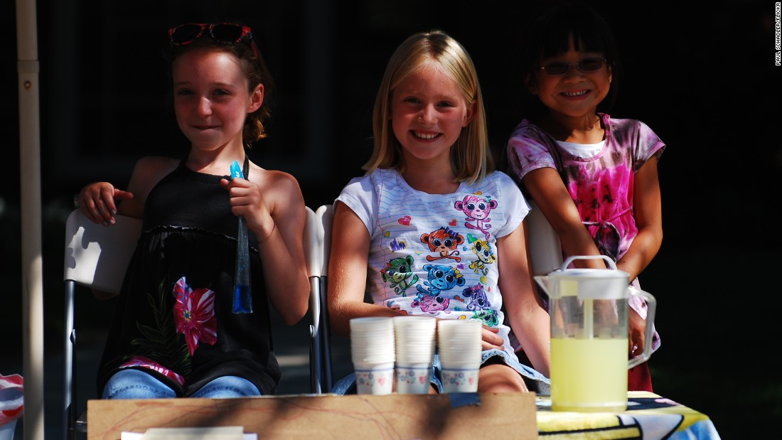 Three girls set up a neighborhood lemonade stand in July 2010.