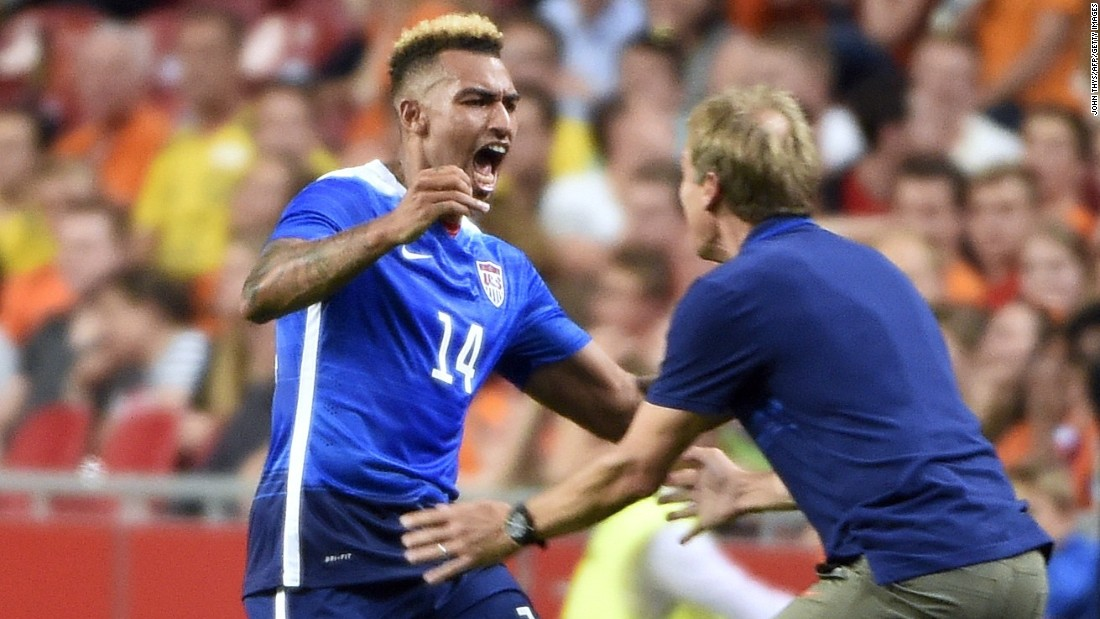 Danny Williams celebrates his equalizer against the Netherlands with coach Jurgen Klinsmann. His team were 3-2 down with just two minutes to go, but managed to turn the game around for a 4-3 win.