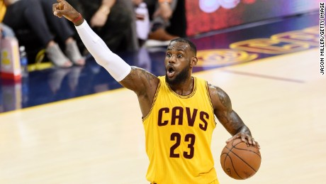 LeBron James #23 of the Cleveland Cavaliers yells to his team during Game Three of the 2015 NBA Finals against the Golden State Warriors at Quicken Loans Arena on June 9, 2015 in Cleveland, Ohio.