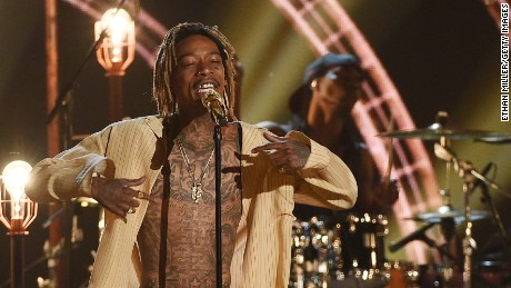 LAS VEGAS, NV - MAY 17: Rapper Wiz Khalifa (L) and violinist Lindsey Stirling perform during the 2015 Billboard Music Awards at MGM Grand Garden Arena on May 17, 2015 in Las Vegas, Nevada. (Photo by Ethan Miller/Getty Images)