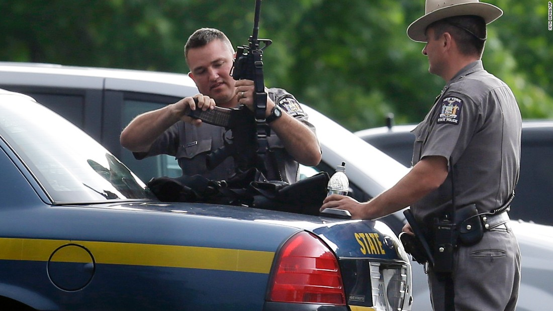 New York State Police prepare equipment during a search for two escaped convicts near Dannemora, New York, on Thursday, June 11.