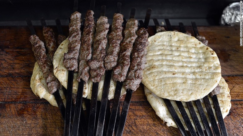 You can't go wrong with meat on a stick. Skewers of grilled kebab on pita bread await their fate at an Athens souvlaki restaurant.