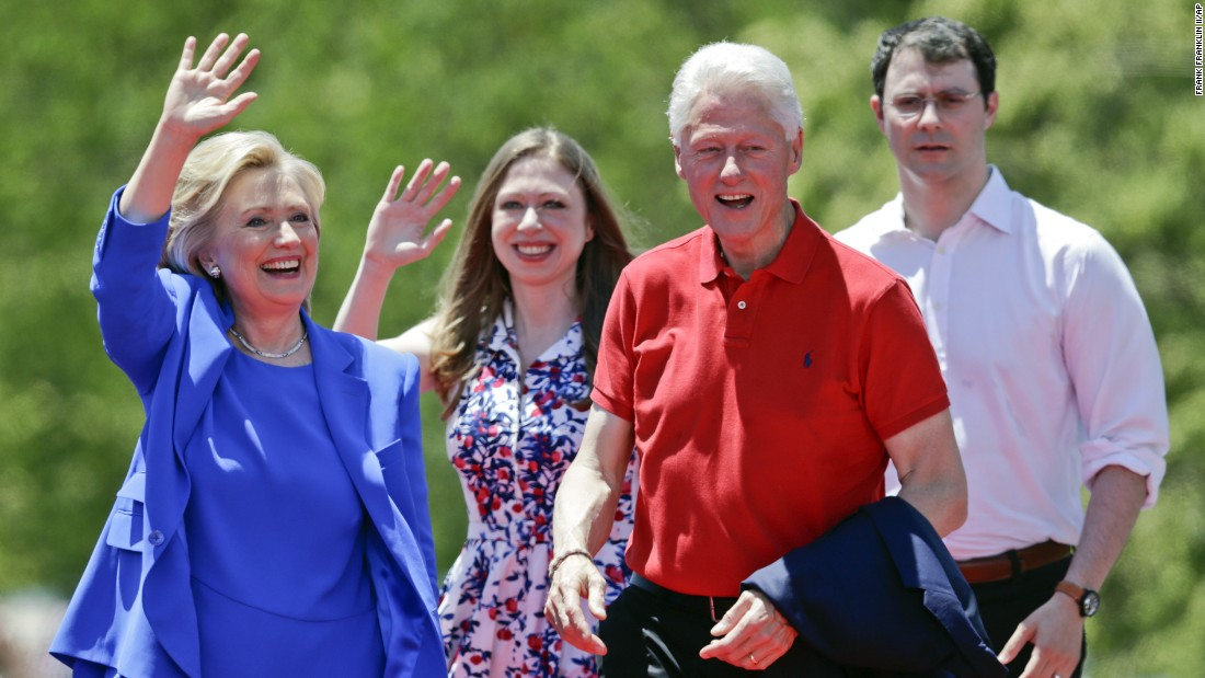 Clinton waves to supporters as former President Bill Clinton, Chelsea Clinton and Marc Mezvinsky, Chelsea's husband, join her onstage.