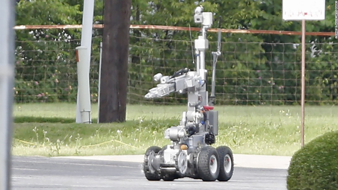 Police use a robot to gain access to the suspect's van, which authorities believed was rigged with explosives.