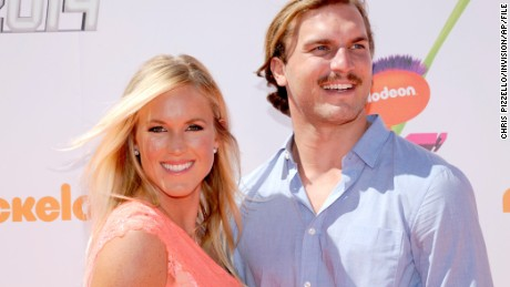 Bethany Hamilton, left, and Adam Dirks arrive at the Kids#39; Choice Sports Awards at UCLA#39;s Pauley Pavilion on Thursday, July 17, 2014, in Los Angeles. (Photo by Chris Pizzello/Invision/AP)