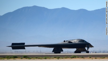 A B-2 Stealth Bomber lands at the Palmdale Aircraft Integration Center of Excellence in Palmdale, California on July 17, 2014, as the US Air Force and manufacturer Northrop Grumman celebrated the 25th anniversary of the B-2 Stealth Bomber's first flight. Northrop Grumman is the prime contractor for the US Air Force's B-2 stealth bomber, a key component in the nation's long range strike arsenal and one of the most survivable aircraft in the world.  AFP PHOTO/Frederic J. BROWN        (Photo credit should read FREDERIC J. BROWN/AFP/Getty Images)
