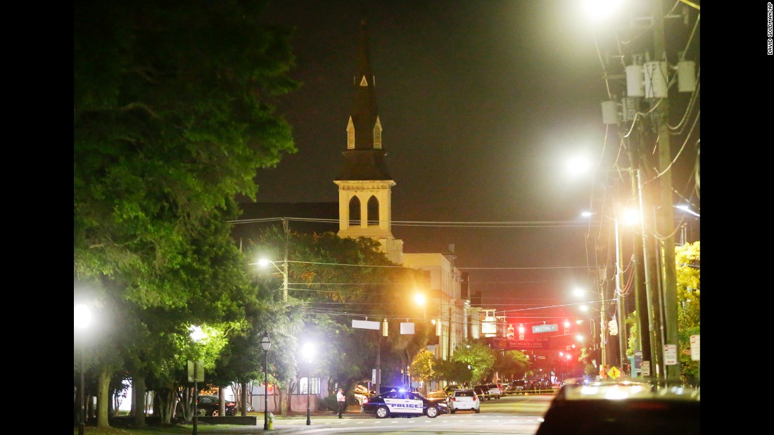 Police in Charleston close off a section of Calhoun Street early on June 18, following the shooting. The steeple of the church is visible in the background.