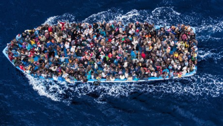 Hundreds of refugees and migrants aboard a fishing boat are pictured moments before being rescued by the Italian Navy as part of their Mare Nostrum operation in June 2014.