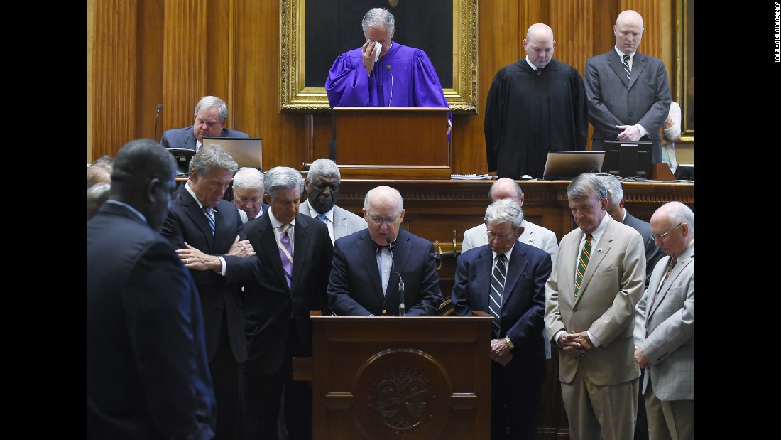 Chaplain James St. John leads senators in prayer June 18 at the statehouse in Columbia.
