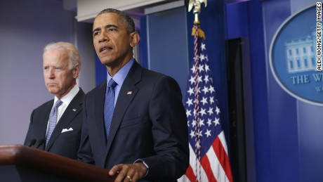 President Barack Obama, flanked by Vice President Joe Biden, makes a statement regarding the shooting in Charleston, South Carolina, June 18, 2015 at the James Brady Press Briefing Room of the White House in Washington, DC. Authorities have arrested 21-year-old Dylann Roof of Lexington County, South Carolina, as a suspect in last night's deadly shooting at the Emanuel AME Church in Charleston, South Carolina, killing nine people.