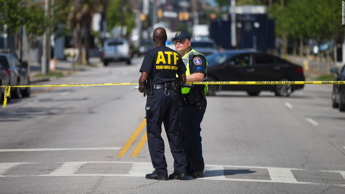 Law enforcement officers in Charleston stand guard Thursday, June 18, near the scene of the church shooting.