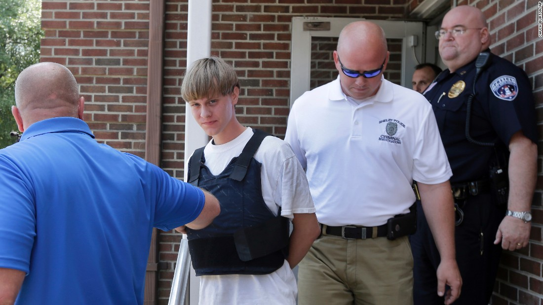 Dylann Roof, the 21-year-old suspected of killing nine people in a church shooting on Wednesday, June 17, is escorted by police in Shelby, North Carolina, on Thursday, June 18.