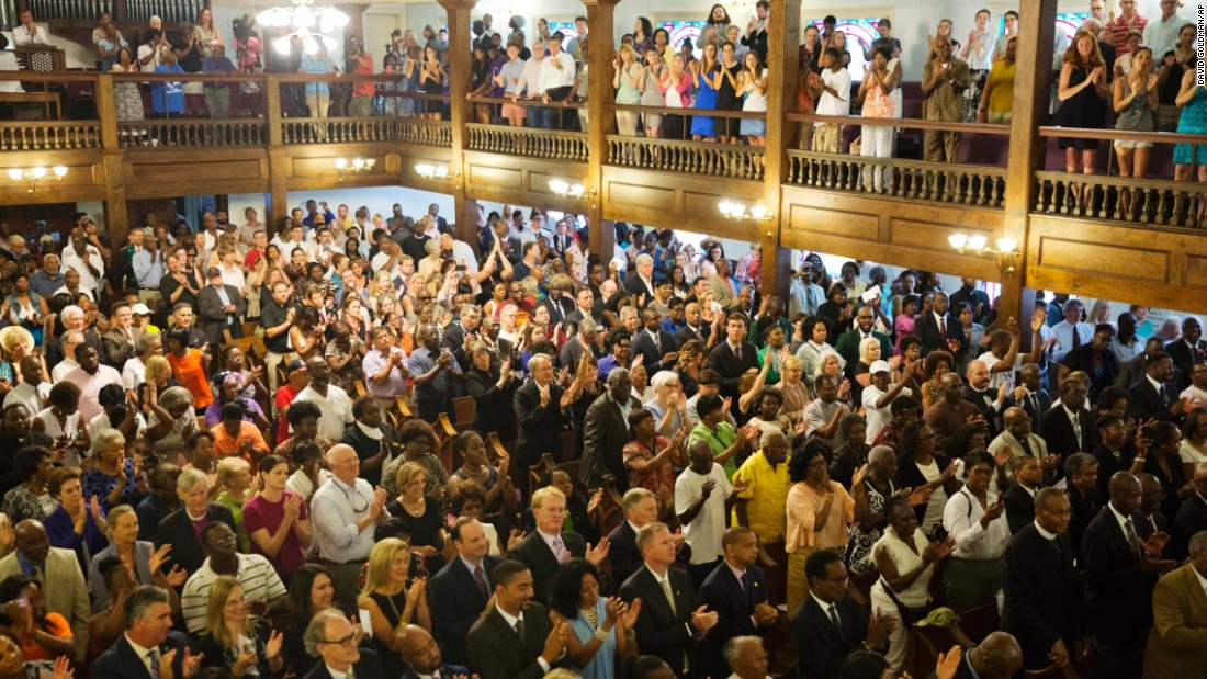 "Parishioners applaud during a  memorial service on Thursday, June 18, at Morris Brown AME Church in Charleston, South Carolina. The service remembered the<a href=""http://www.cnn.com/2015/06/18/us/gallery/charleston-south-carolina-church-shooting/index.html"" target=""_blank""> nine people killed Wednesday</a>, June 17, during a prayer meeting inside Charleston's Emanuel AME Church. Police arrested suspect Dylann Storm Roof, 21, on Thursday in Shelby, North Carolina, without resistance."