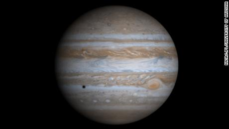 This image of Jupiter is a composite of four images taken by NASA's Cassini spacecraft in December, 2000. The images were combined to illustrate what Jupiter would look like if the cameras on Cassini  had captured the entire planet. Jupiter's moon Europa is casting the dark shadow on the planet.