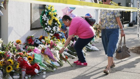 CHARLESTON, SC - JUNE 19:  Mourners lay flowers outside the historic Emanuel African Methodist Episcopal Church June 19, 2015 in Charleston, South Carolina. South Carolina Governor Nikki Haley called for the death penalty for Dylann Storm Roof, 21, of Lexington, South Carolina, if he is found guilty of murdering nine people during a prayer meeting at the church Wednesday night. Among the dead is the Rev. Clementa Pinckney, the pastor of the church which, according to the National Park Service, is the oldest black congregation in America south of Baltimore.  (Photo by Chip Somodevilla/Getty Images)