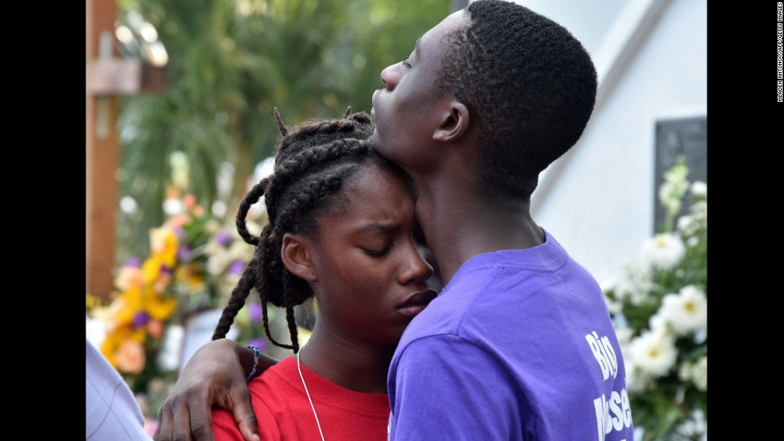 Young people grieve outside Emanuel African Methodist Episcopal Church in Charleston, South Carolina, on June 19.